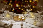 Laid table with christmas tree — Stock Photo