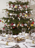 Festive table with christmas tree — Stock Photo
