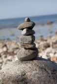 Stone tower on rocks — Stock Photo