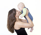 Mother kisses her baby — Stock Photo