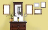 Yellow wall with picture frame — Stock Photo