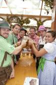 Oktoberfest visitors drink beer — Stock Photo