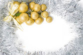 Christmas background with gold and silver ornaments to insert te — Stok fotoğraf