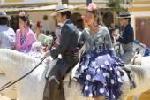 Couple on horseback at the fair — Stock Photo