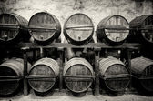 Barrels stacked in the winery in black and white — Stock Photo