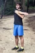 Male athlete doing stretching — Zdjęcie stockowe