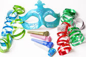 Carnival mask with colorful streamers and party horns on white b — Stock Photo