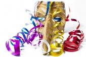 Carnival mask with colorful streamers on white background — Stock Photo