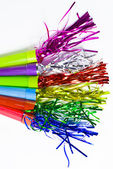 Party Horn Blower with colored streamers on white background — Stock Photo