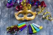 Carnival mask with colorful streamers and party blowers — Stock Photo