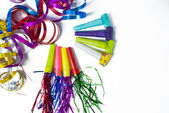 Party items, blowers and colorful streamer  — Stock Photo