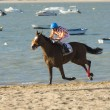 Horse racing on the beaches of Sanlucar — Stock Photo #78234560