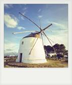 Instant photo old windmill in Vejer de la Frontera, Andalusia, S — Stock Photo