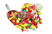 Glass jar full of candies isolated in white background — Stock Photo