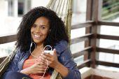 Brunette woman on hammock with cell phone — Foto de Stock