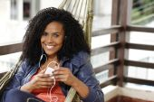Brunette woman on hammock with cell phone — Foto Stock