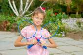 Cute girl with racket Outdoors — Stock Photo