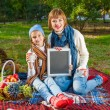 Happy mother with little daughter in autumn park — Stock Photo #57620801
