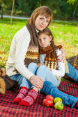 Happy mother with little daughter in autumn park — Stock Photo