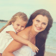 Mother and her little daughter hugging. — Stock Photo #69562513
