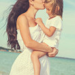 Mother and her little daughter hugging. — Stock Photo #69562545