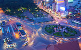 Asia traffic, roundabout, Ben Thanh bus stop — Stock Photo