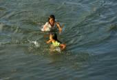 Asian children bath on Vietnamese river — Stock Photo
