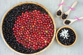 Collect of cofee bean,  ripe berries, black roasted — Stock Photo