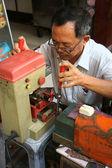 Asian man repair key — Stock Photo