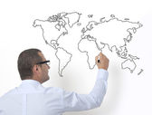 Teacher drawing the world map — Stock Photo
