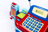 Colorful toy cash register on white background — Stock Photo