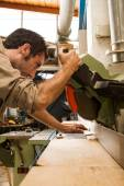 Young carpenter work with circular saw — Stock Photo
