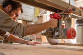 Young carpenter work with circular saw — 图库照片