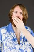 Shocked Model covering his mouth — Stock Photo