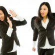 Two Asian young businesswoman dressed as black angel fighting with each other isolated on white background — Stock Photo #57699271