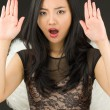 Asian young woman dressed up as an angel with making stop gesture sign from both hands — Stock Photo #57703327