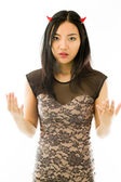 Asian young woman dressed up as a devil  and looking frustrate isolated on white background — Stock Photo