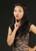 Asian young woman dressed up as an devil standing with hand on hip — Stock Photo