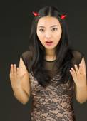 Asian young woman dressed up as an devil looking frustrate — Stock Photo