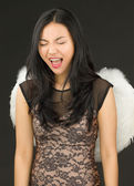 Asian young woman dressed up as an angel with shouting in excitement — Stock Photo