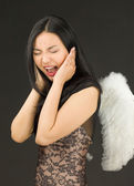 Asian young woman dressed up as an angel shouting in frustration — Foto de Stock
