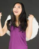 Angel side of a young Asian woman celebrating success and making fist with both hands — Stock Photo