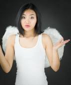 Asian young woman dressed up as an angel dont know what to do — Stock Photo