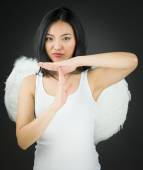 Asian young woman dressed up as an angel making time out signal with hands — Stock Photo