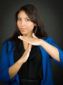 Young businesswoman making time out signal with hands — Stock Photo