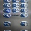 Full frame of numbered buttons with braille markings on elevator panel — Stock Photo #67388839