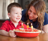 Boy celebrating his birthday with his mother — Stock Photo