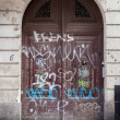 Graffiti on entrance gate of a building, Barcelona, Catalonia, Spain — Stock Photo #67392337