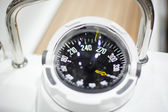 Navigational compass of a boat — Stock Photo