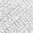 Cyrillic alphabet letters paper background. black and white background — Stock Photo #70727155